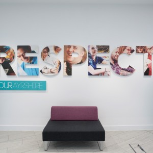 Acrylic Text with Vinyl Print to Face. Fixed to Internal Wall with Stand-off Fixings.